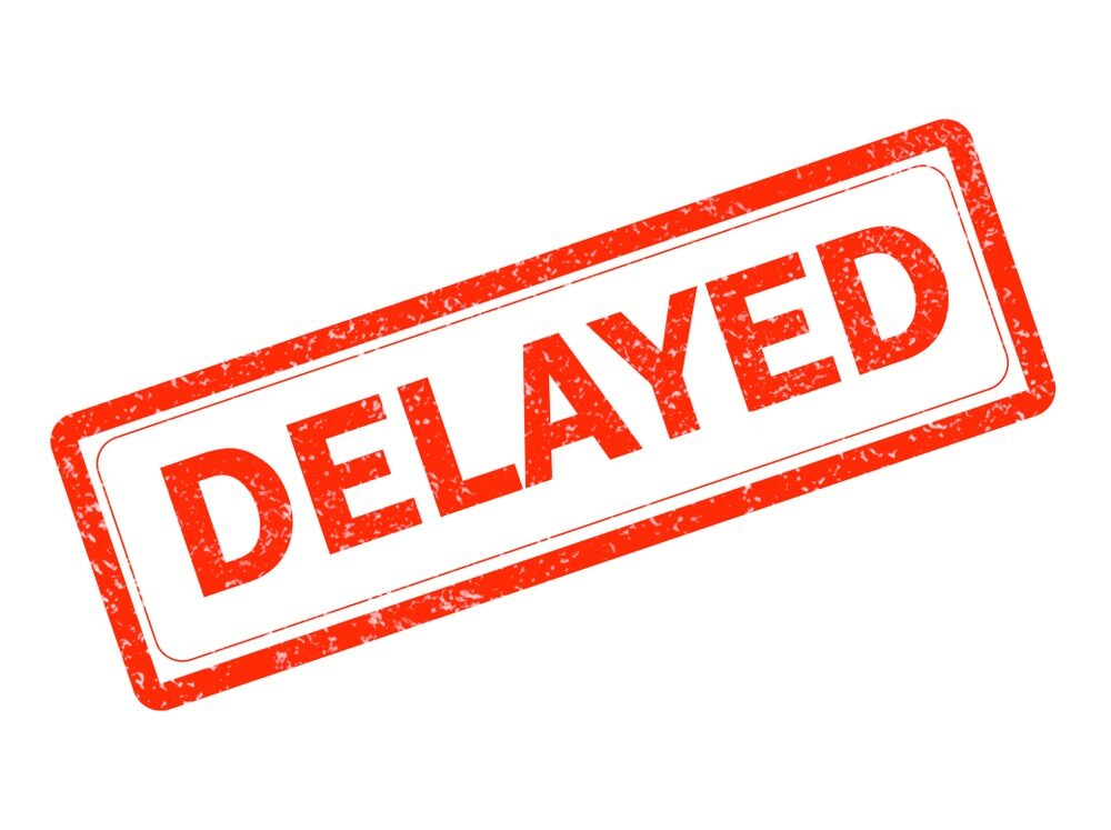 delayed red rubber stamp on white background. delayed stamp sign. text delayed stamp.